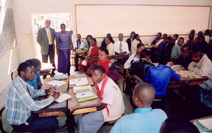 Dr. Mehraban Khodavandi visits the classroom of Catherine Kutsaira (LC '04) at Lilongwe Teacher Training College in Malawi