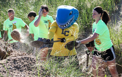 Musko and several Lakeland students lend a hand at the college's fifth annual